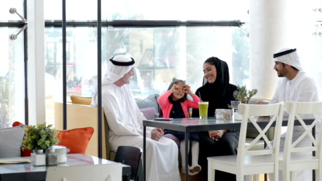 three-generation emirati family at cafe - family stock videos & royalty-free footage