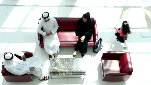 Three-generation Emirati family on the lounge