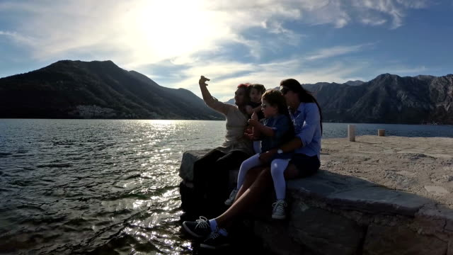 three-generation family enjoying vacation slow motion - perast stock videos and b-roll footage