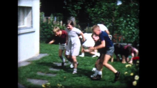 1965 three-legged race at backyard birthday party