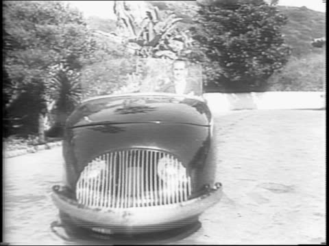 three-wheeled car speeds up a deserted country road / the car stops and drives in tight circles. - three wheeled pushchair stock videos & royalty-free footage
