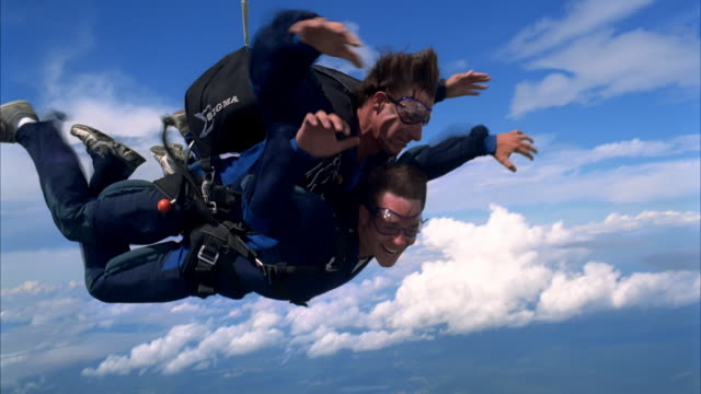 thrilled tandem student - parachuting stock videos and b-roll footage