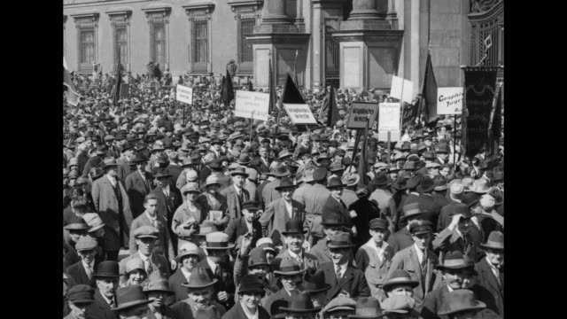 throng of people at lustgarten many carrying placards / crowd at altes museum - may day international workers day stock videos & royalty-free footage