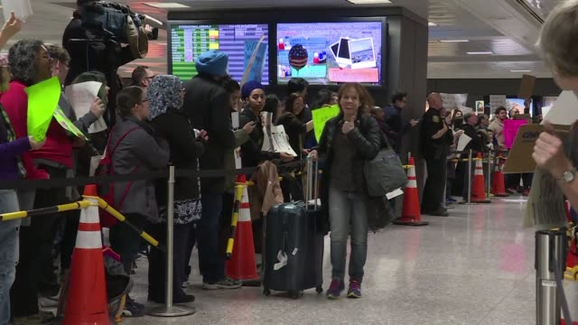throngs of noisy demonstrators and scores of lawyers pour into dulles international airport outside washington to show support for immigrants... - dulles international airport stock videos and b-roll footage