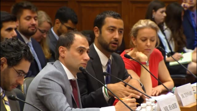 Through a translator Mohamed Tennari of the SyrianAmerican Medical Society tells a House Foreign Affairs Committee member about strategy for chemical...