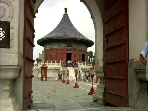 MS through archway to Imperial Vault of Heaven in courtyard of Temple of Heaven, Beijing, China