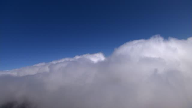 Through blowing vapor, canyon at right