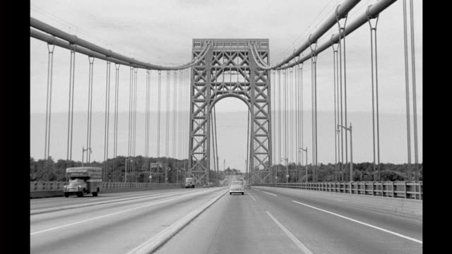 vídeos de stock, filmes e b-roll de pov through dark tunnel then emerge onto george washington bridge headed westbound from manhattan / crosses bridge driving through tollgate george... - tunnel