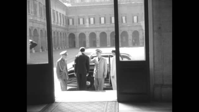 pov through doorway as gen matthew ridgway supreme allied commander europe arrives shakes hands with officials aide escorts him inside as he shakes... - matthew b. ridgway stock-videos und b-roll-filmmaterial