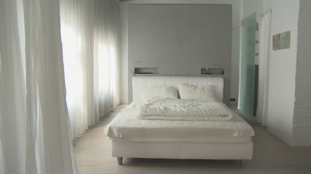 ms ts through modern loft decorated in white/ berlin, germany - modern bedroom stock videos & royalty-free footage