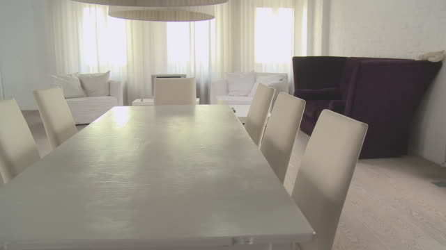 ms ts through modern loft decorated in white/ berlin, germany - dining table stock videos & royalty-free footage