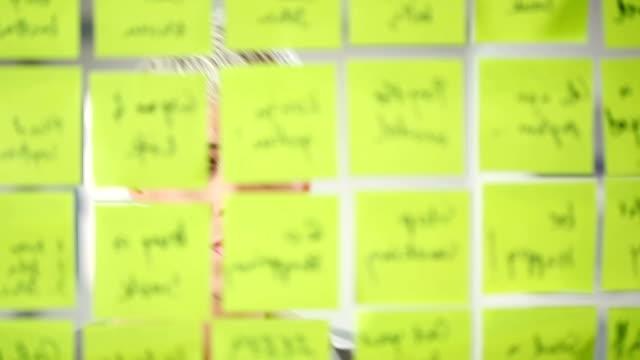 durch papier noten - viele gegenstände stock-videos und b-roll-filmmaterial