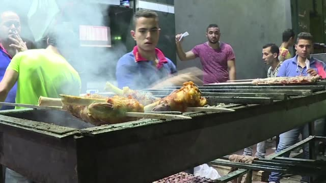 through streets strewn with rubbish where laundry lines hang from shabby apartment blocks the tantalising smell of grilled kebabs lures patrons from... - cairo stock videos & royalty-free footage