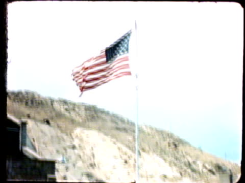 prison guard, corrections officer, walking along tower balcony w/ rifle in hand. vs united states flag in csp prison yard. co, jail - prison guard stock videos & royalty-free footage