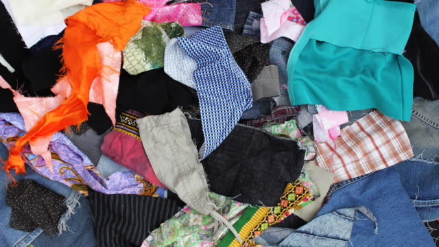 throw away many pieces of scrap fabric. - cotton stock videos & royalty-free footage