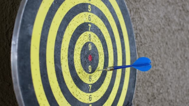 throw blue arrow miss canter to target board hang on wall - bull's eye stock videos and b-roll footage