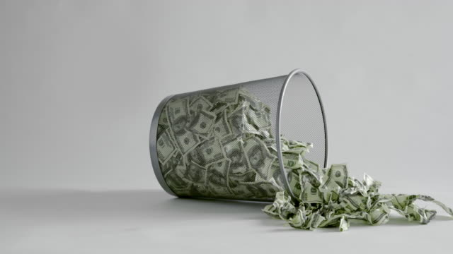 throwing american dollars bills into trash bin - debt stock videos & royalty-free footage