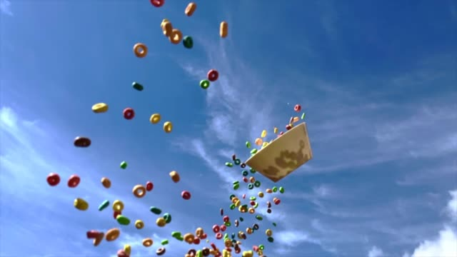 throwing colorful cereals with blue sky and beautiful visual effect. - visual merchandising stock videos and b-roll footage