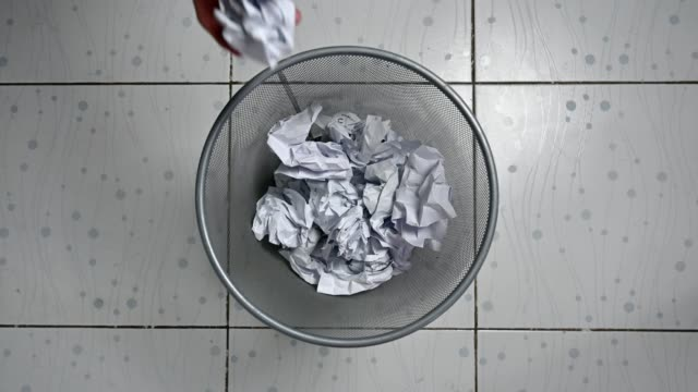 throwing crumpled papers in metallic mesh trash can - mesh textile stock videos & royalty-free footage