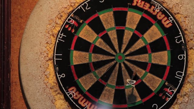 Throwing Dart at Dart Board
