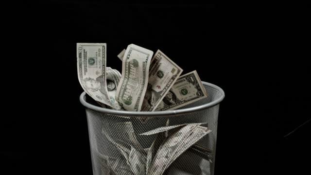 SLO MO Throwing money away