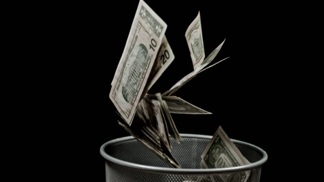 vídeos de stock e filmes b-roll de slo mo throwing money away - economy