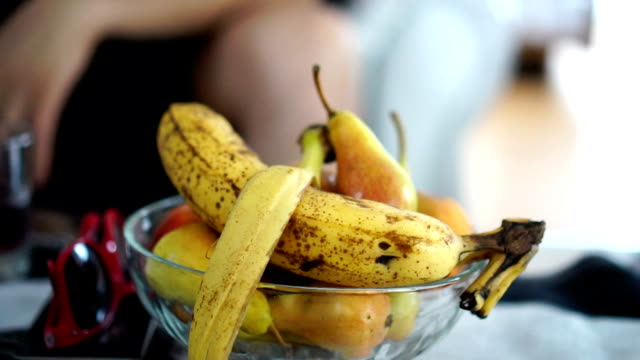 slow motion - thrown banana peel on bowl of fruit - fruit bowl stock videos & royalty-free footage