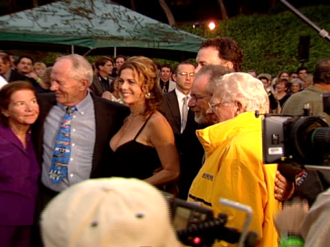 thru crowd- stephen ambrose, rita wilson, tom hanks, steven spielberg and donald malarkey posing for pictures on red carpet at hollywood bowl - rita wilson actress stock videos & royalty-free footage