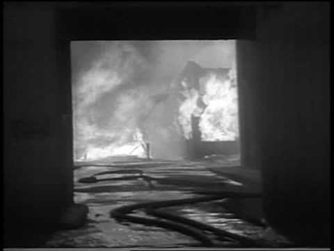 vidéos et rushes de b/w 1934 thru doorway of building on fire in chicago stockyard / newsreel - 1934