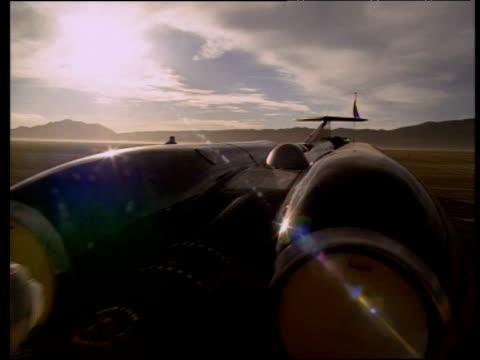 thrust ssc being towed backwards in black rock desert nevada 1997 - ネバダ州点の映像素材/bロール