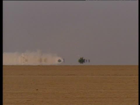 Thrust SSC slowing down as it emerges from heat haze after test run in desert Jordan May 97