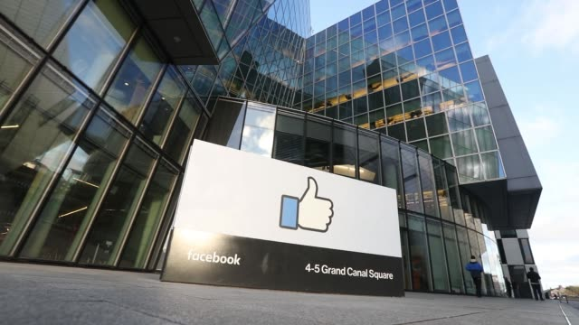 stockvideo's en b-roll-footage met a thumbs up symbol stands at the entrance to the facebook inc european headquarters in dublin ireland on thursday nov 24 2016 - hoofdkantoor
