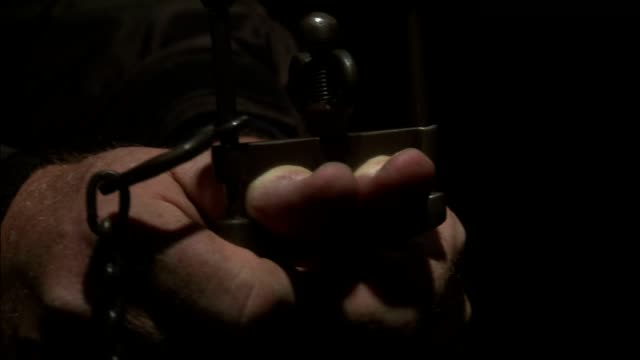 thumbscrews are applied to the hands of a prisoner. - torture stock videos & royalty-free footage