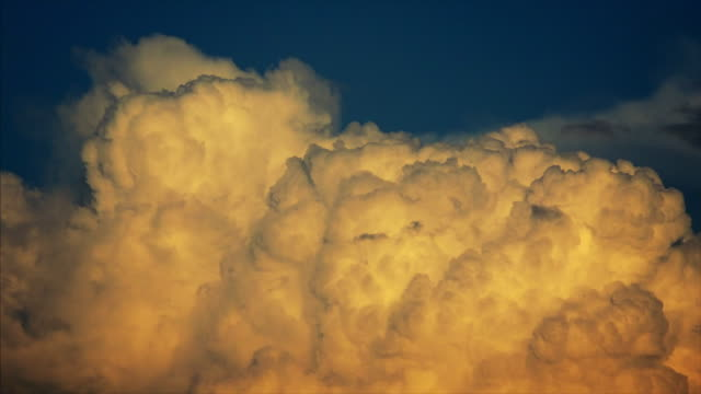 Thunder Clouds Build in The Atmosphere at Sunset - Time Lapse