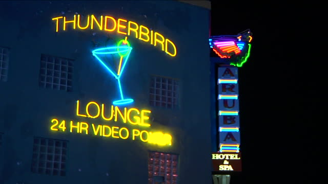 thunderbird lounge 24 hr video poker aruba hotel spa neon lights signs on building neon light martini glass w/ moving olive out/in focus sin city old... - martini glass stock videos and b-roll footage