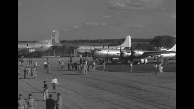 thunderbirds precision flight over field / pan air craft on tarmac people walking around them / vs jimmy stewart stoops to sign autographs for circle... - thunderbirds stock videos and b-roll footage