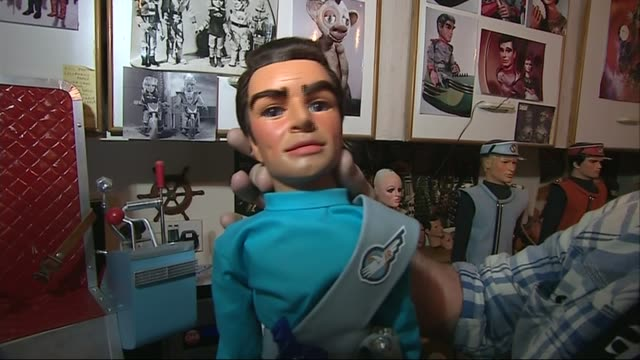 thunderbirds show returns to television; vaughan herriott taking original 'scott' puppet out of chair herriot making costume with sewing machine... - puppet stock videos & royalty-free footage