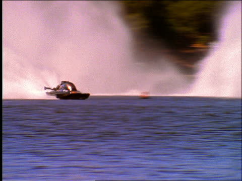 thunderboat speeding on lake - schnellboot stock-videos und b-roll-filmmaterial