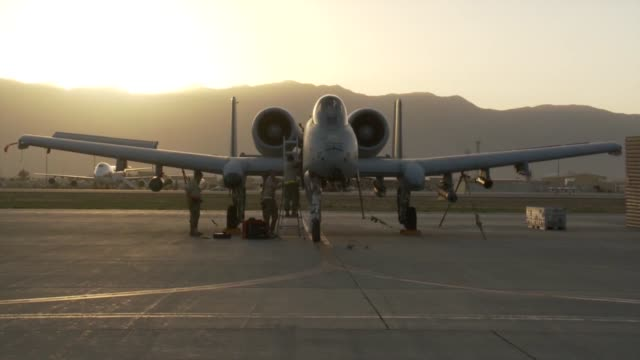 thunderbolt ii aircraft of the 303rd expeditionary fighter squadron at bagram airfield afghanistan during sunset hours. - bagram stock videos & royalty-free footage
