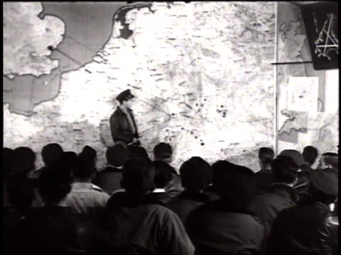 thunderbolt pilots of usaaf sitting in war room receiving briefing for mission / united kingdom - 1944 stock videos & royalty-free footage