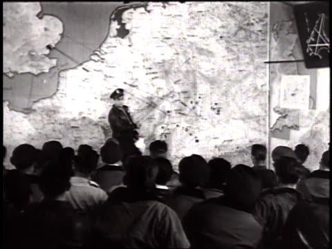 thunderbolt pilots of usaaf sitting in war room receiving briefing for mission / united kingdom - wackelaufnahme stock-videos und b-roll-filmmaterial