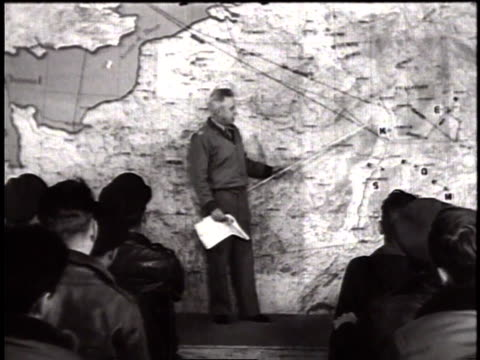 thunderbolt pilots of usaaf sitting in war room receiving briefing for mission with the intelligence officer at the pointer / united kingdom - 1944 stock videos and b-roll footage