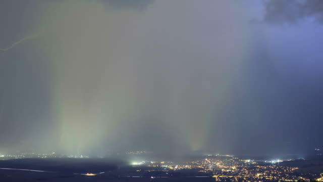 thunderstorm and rain over urban landscape - überschwemmung stock-videos und b-roll-filmmaterial