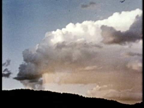 1975 ms thunderstorm clouds over hill / united states / audio - b roll stock videos & royalty-free footage
