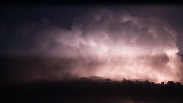thunderstorm clouds with lightning at night - atmosphere filter stock videos & royalty-free footage