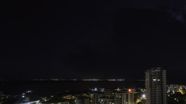T/L WS ZI Thunderstorm with lightning flashing over city and harbor at night / Darwin, Northern Territory, Australia