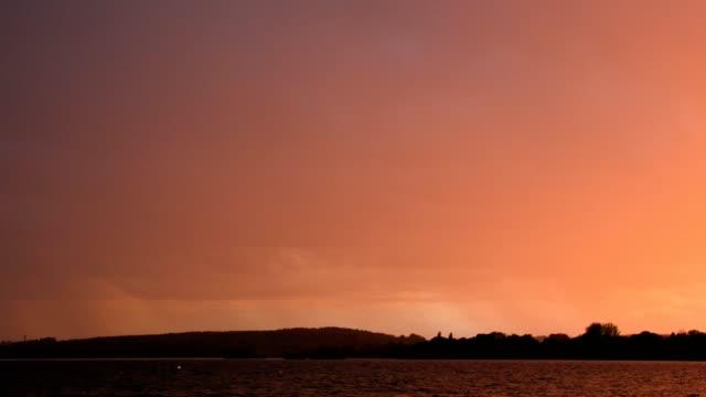 thunderstorm with lightning over lake ammersee, inning stegen, fuenfseenland, upper bavaria, bavaria, germany - inning stock videos & royalty-free footage