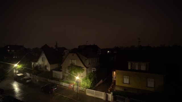 thunderstorm with rain over the strasbourg city, night view - 照明技術点の映像素材/bロール