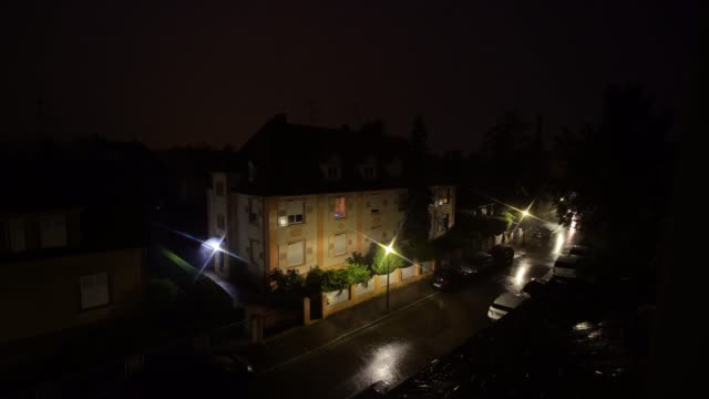 vídeos de stock, filmes e b-roll de thunderstorm with rain over the strasbourg city, night view - poste