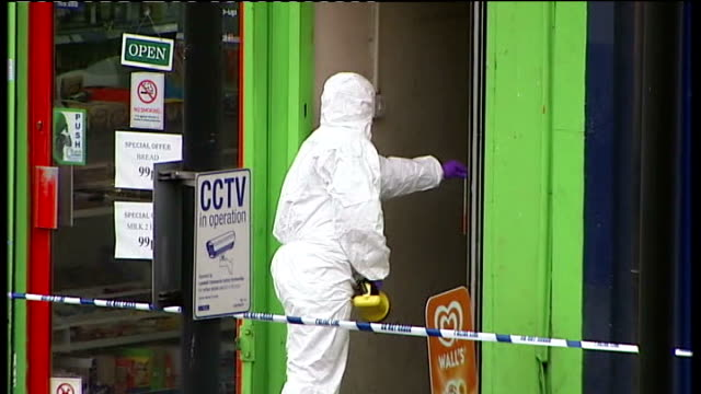thusha kamaleswaran shooting in stockwell police search for gunman tx shots of forensic officer opening shop door behind police cordon - stockwell stock videos and b-roll footage